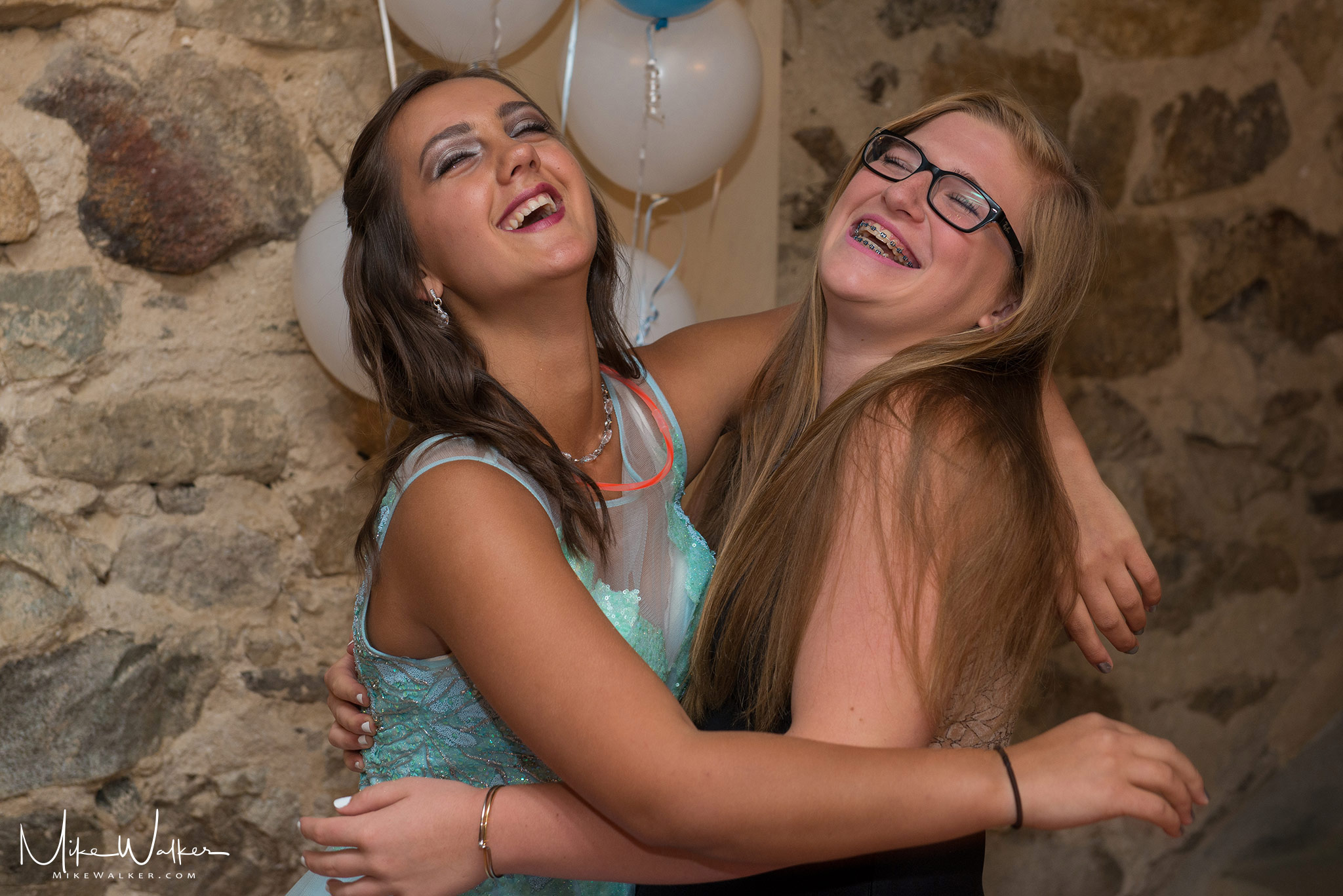Two girls at a sweet 16 party. Event photography by Mike Walker.