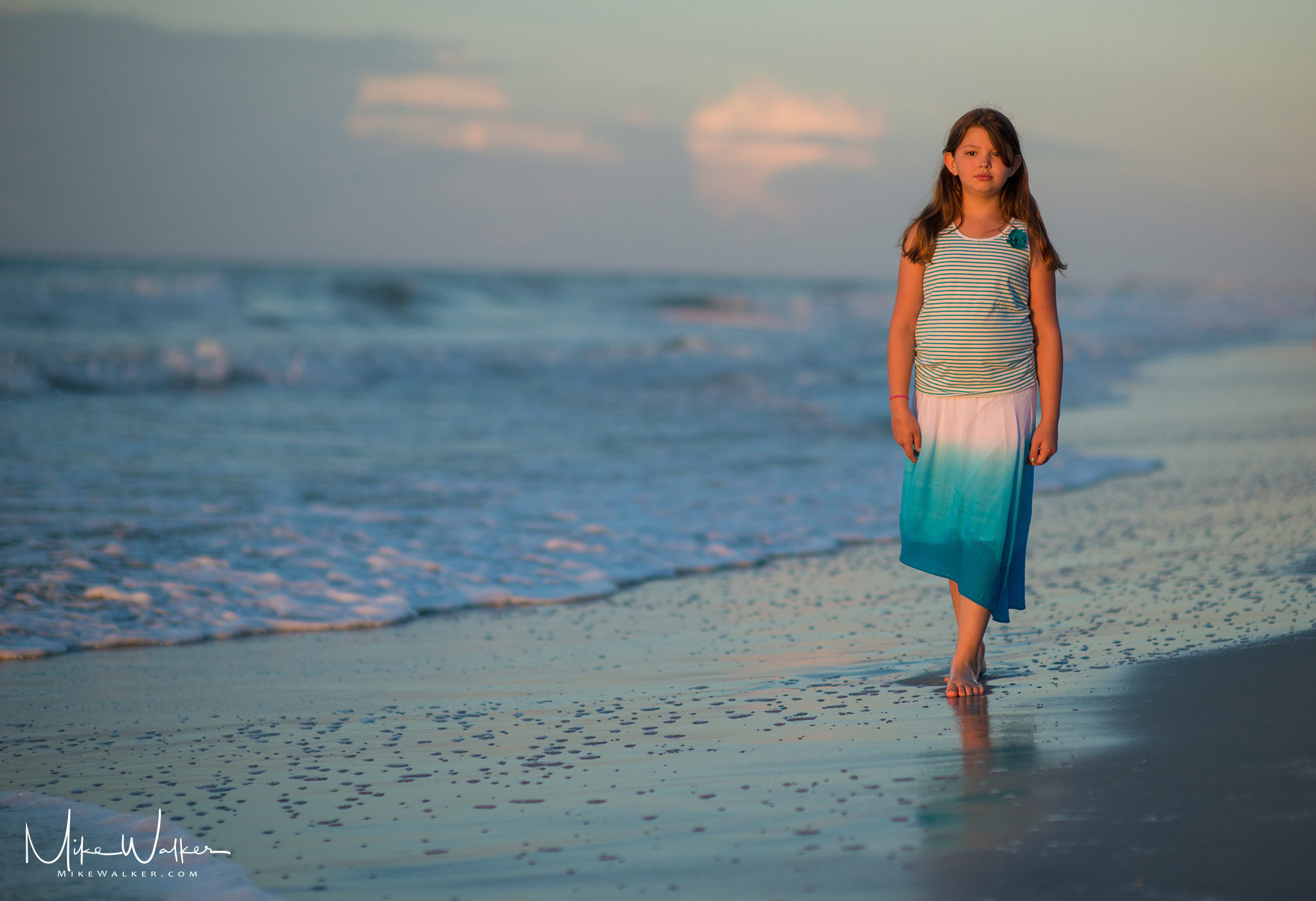 Young girl walking on the beach in the morning. Family photography © Mike Walker