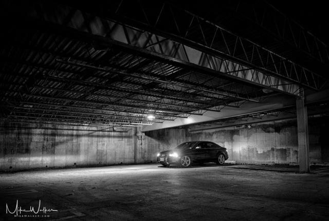 Audi S4 in dark parking garage. Automotive photography by Mike Walker.