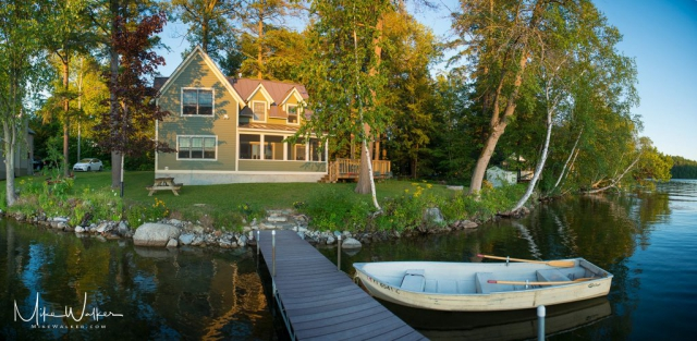 Beautiful house on a lake in Vermont. Travel Photography by Mike Walker.