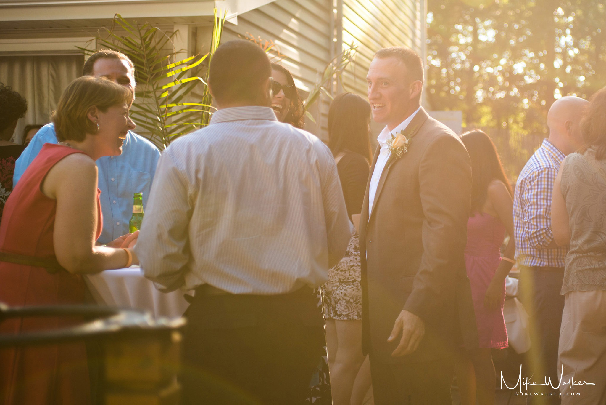 Best man with guests at a wedding. Wedding photographer Mike Walker.