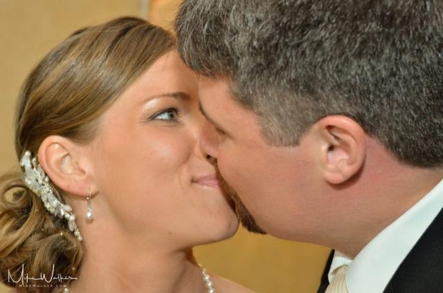 Wedding couple kissing. Wedding photographer Mike Walker.