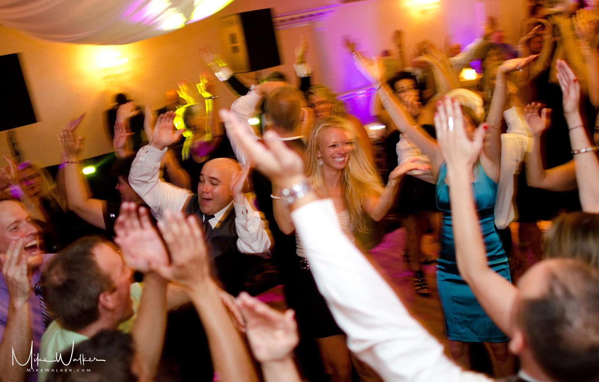 People on the dance floor at a wedding reception. Wedding photographer Mike Walker.