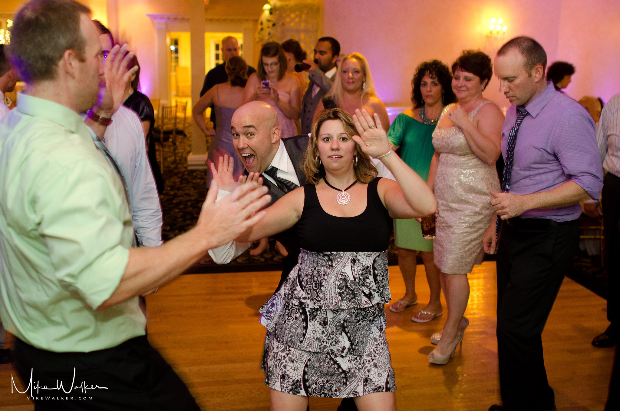 Couple dancing at a wedding. Wedding photography by Mike Walker.