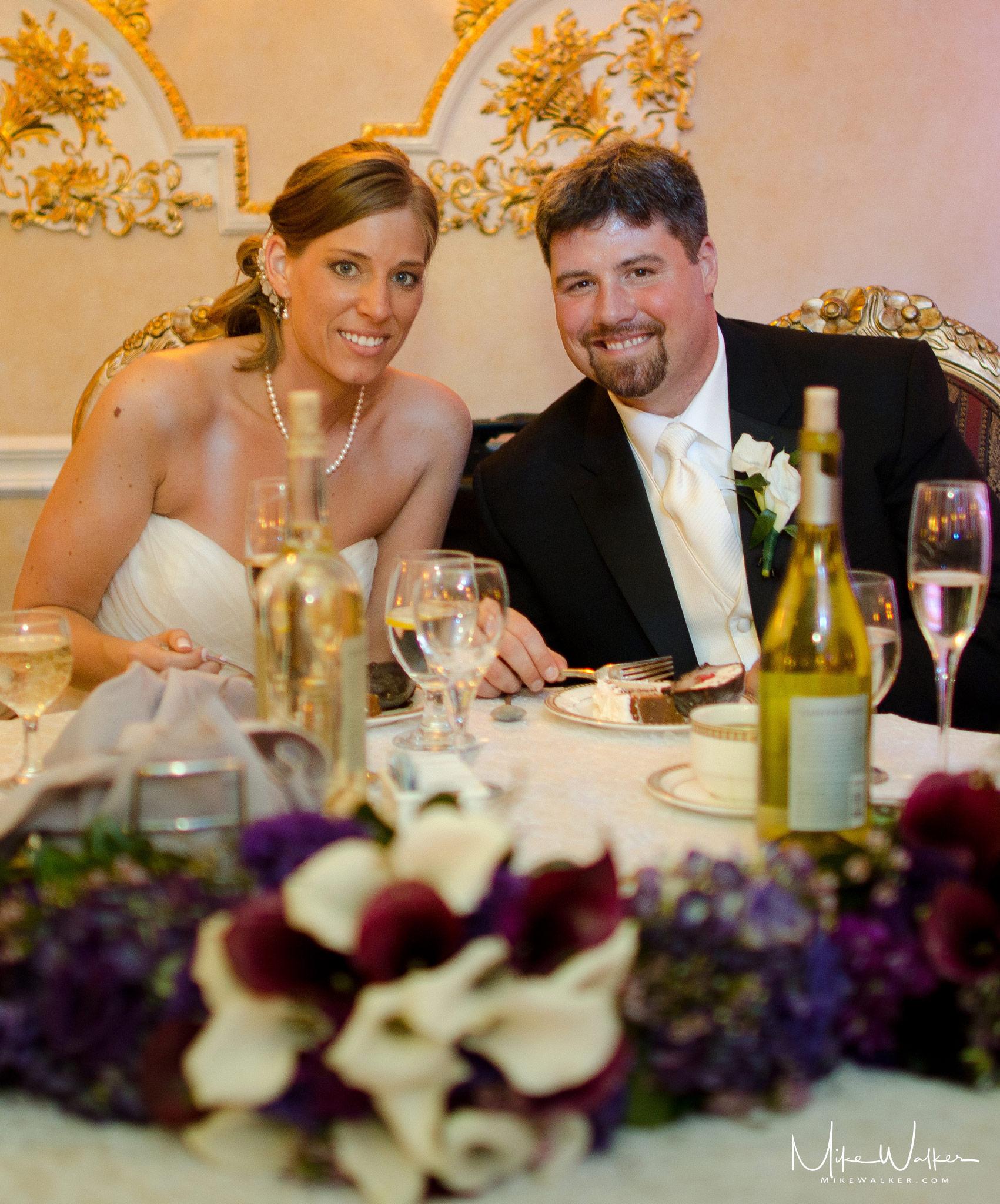 Wedding couple at head table. Wedding photographer - Mike Walker.