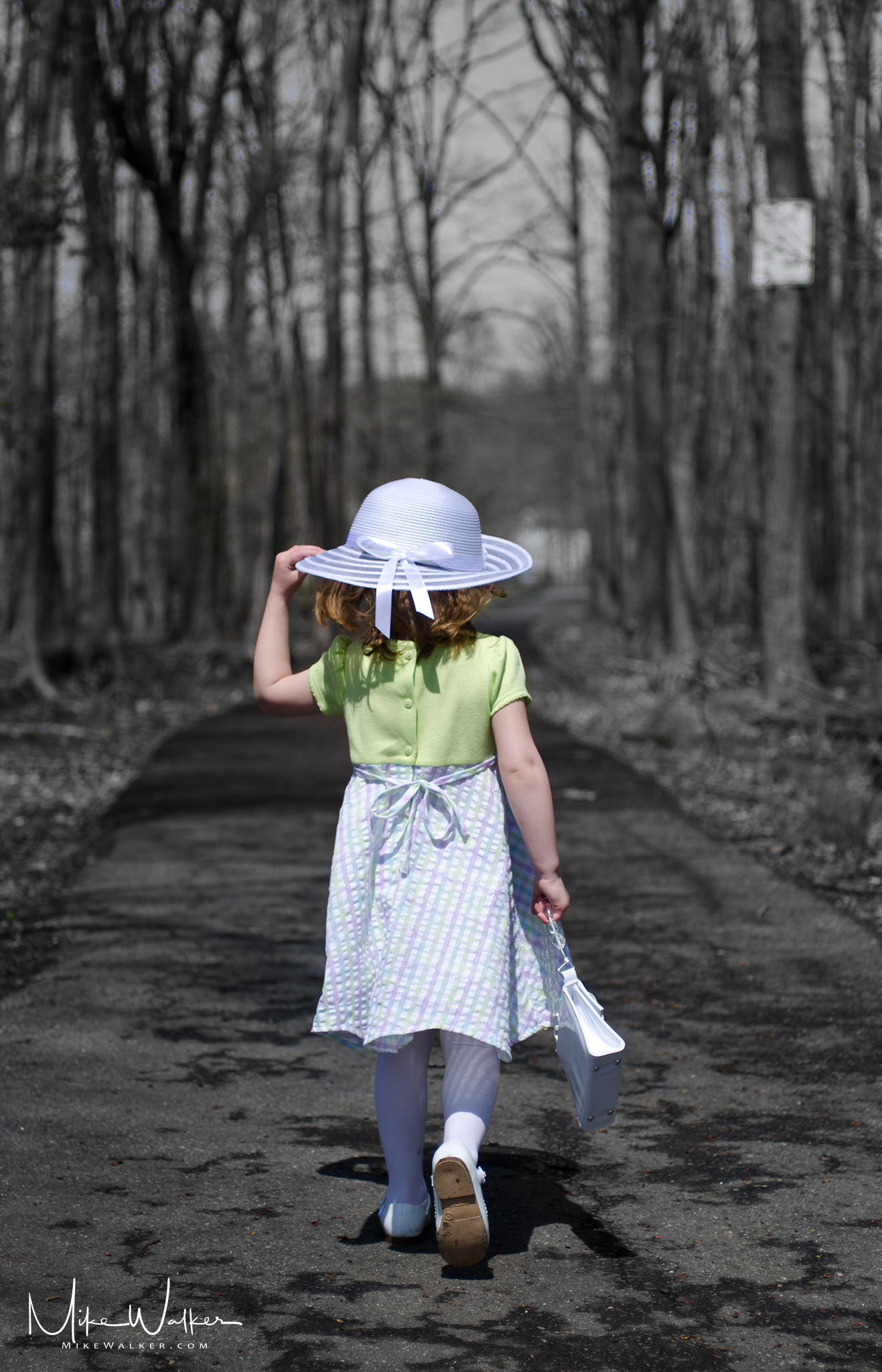 Girl walking down path in the woods. Family photography © Mike Walker