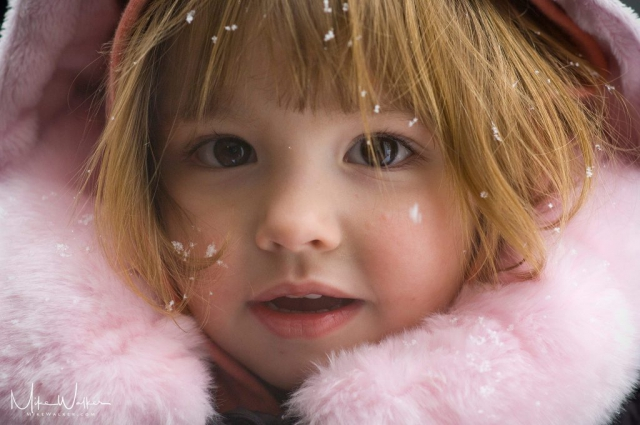 Child in the snow. Family Photography © Mike Walker