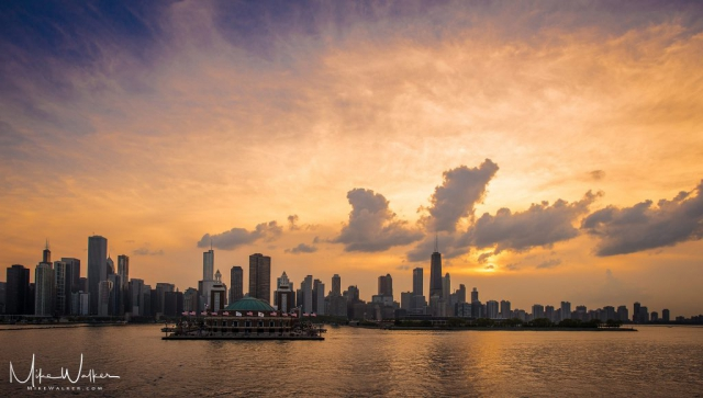 Chicago skyline from Lake Michigan with dramatic clouds. Travel photography by Mike Walker.