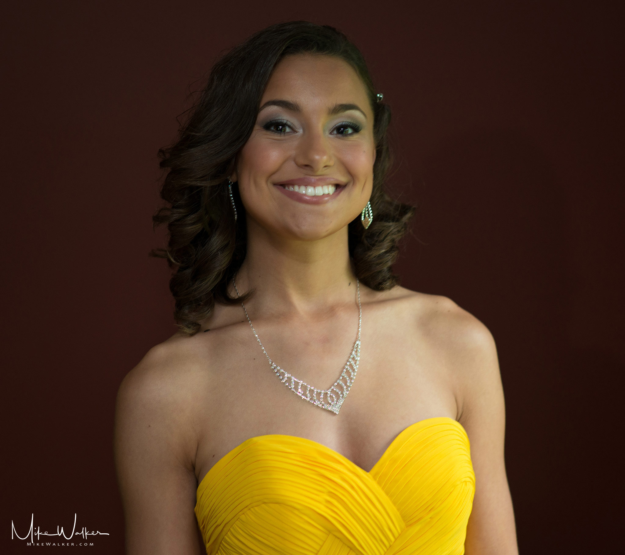 Young woman in a prom dress. Family photography by Mike Walker.