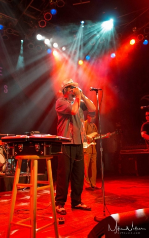 Band performing on stage at the House of Blues in Chicago. Event photography by Mike Walker.