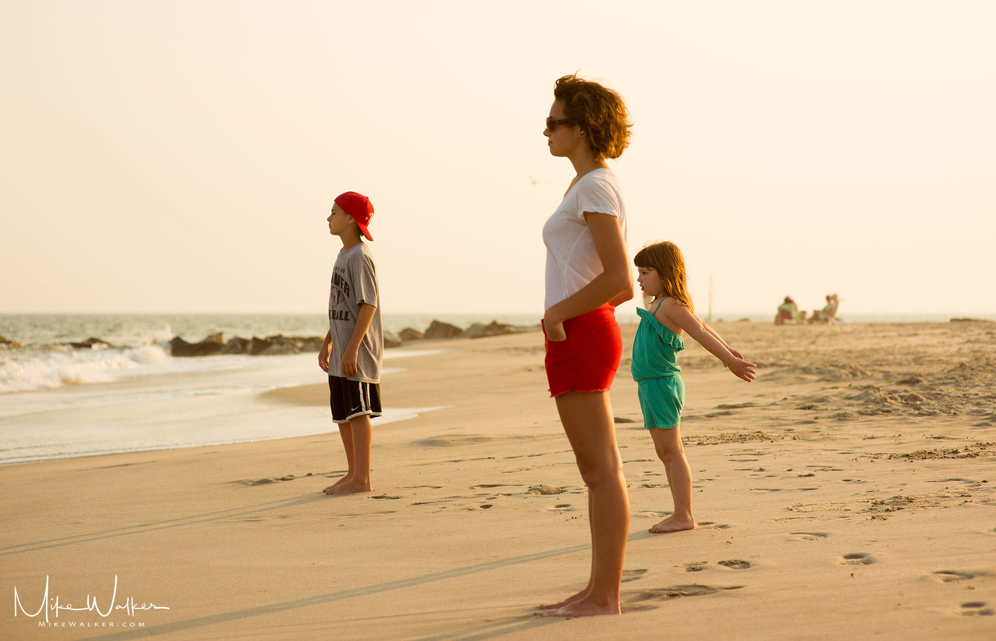 Three kids enjoying the ocean views. Family photography by Mike Walker.