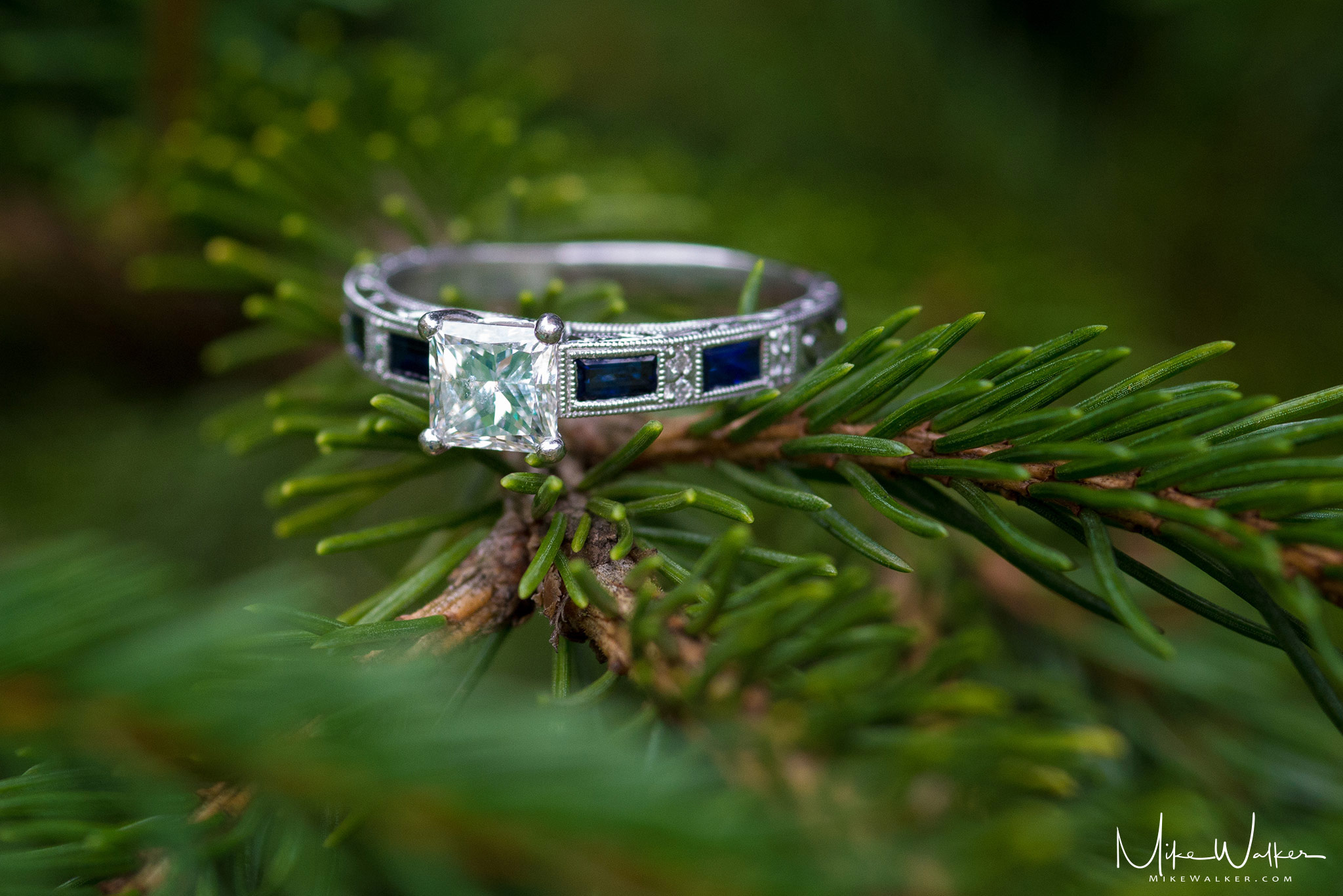 Close up detail of engagement ring. Wedding photography by Mike Walker.