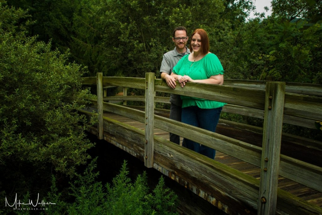 Engaged couple on a bridge. Engagement session by Mike Walker.