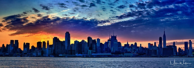 Early morning NY City skyline with dramatic clouds. Travel photography by Mike Walker.