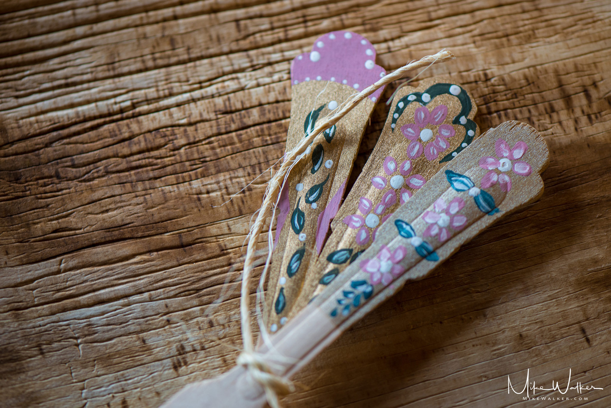 Hand-painted utensils done by the bride for her wedding. Wedding photography by Mike Walker.