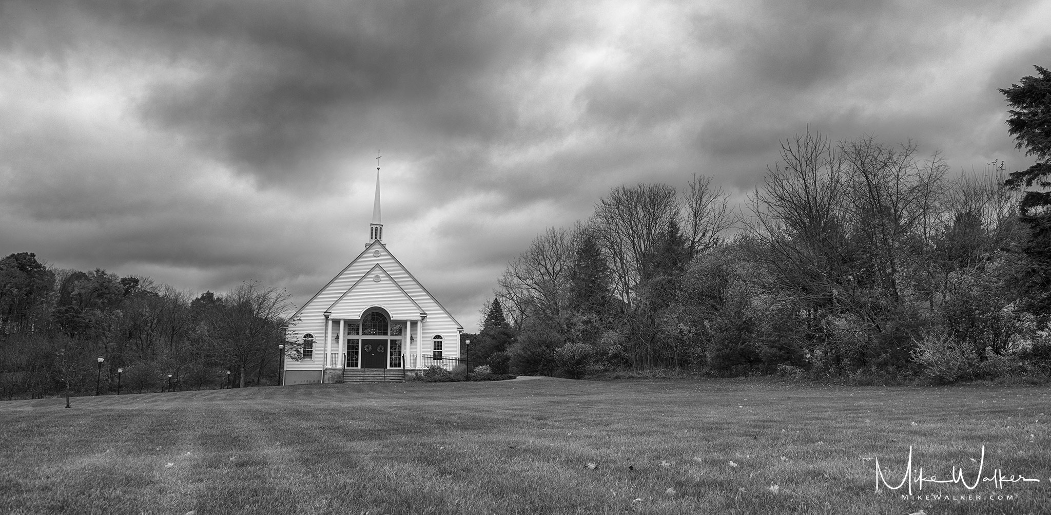 Black and white photo of local church used for a wedding. Wedding photography by Mike Walker.