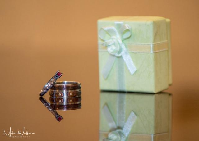 Custom made wedding rings. Wedding photography by Mike Walker.
