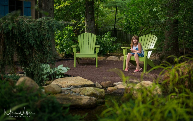 Young girls posing in a luxury backyard setting. Family photography by Mike Walker.