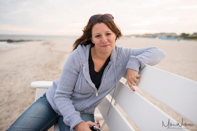 Portrait of a woman on a lifeguard stand. Family photography by Mike Walker.