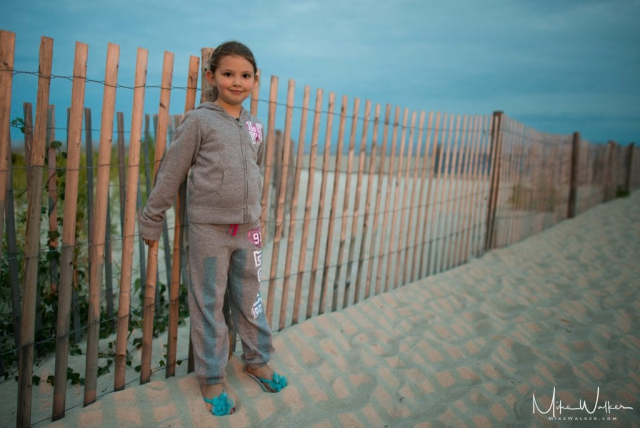 Young girl coming off the beach at the jersey shore. Family photography by Mike Walker.