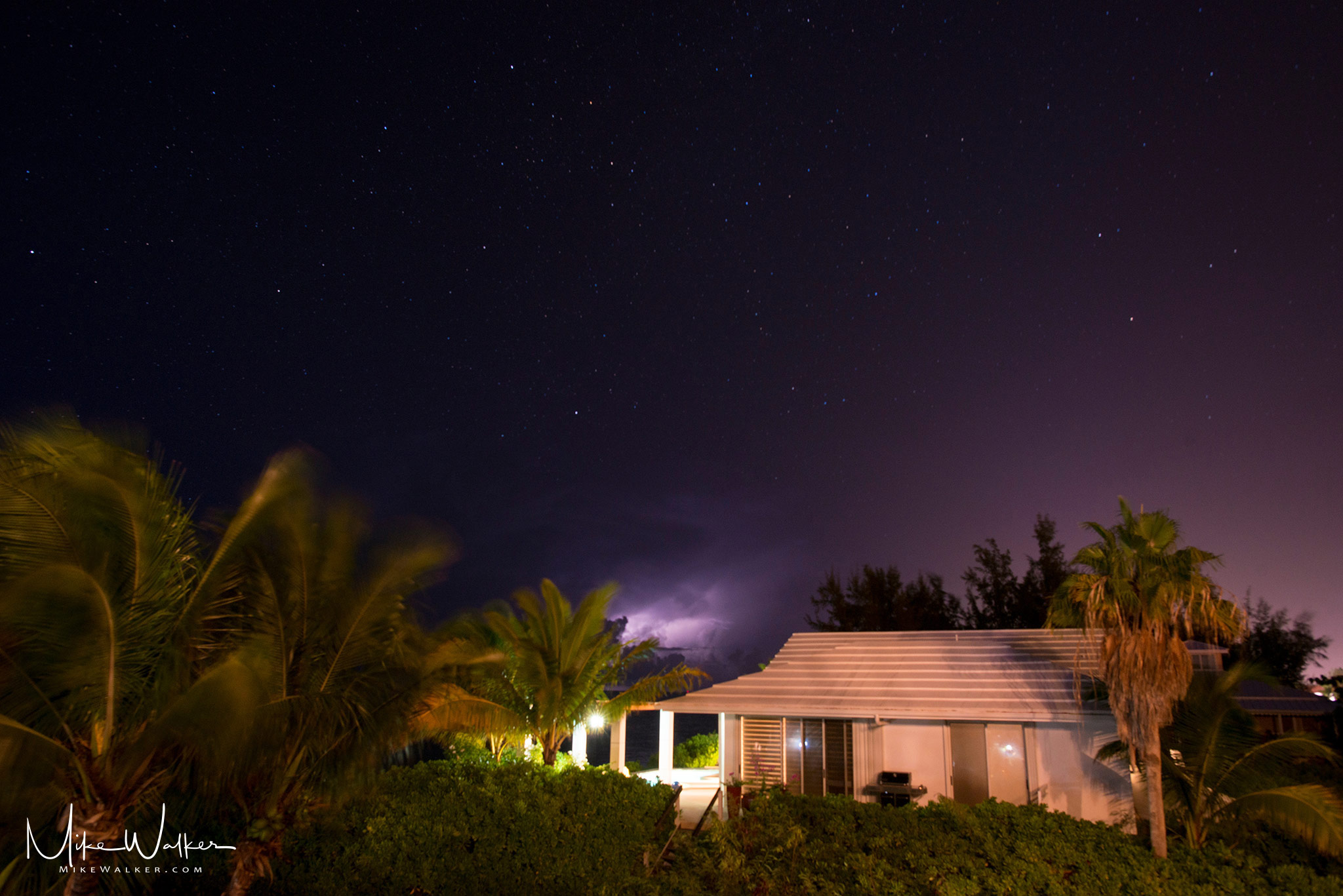 Night photograph with stars and a storm in the distance. Travel photography by Mike Walker.
