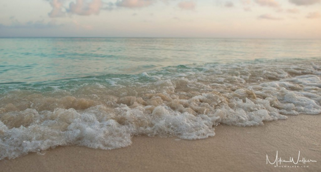 Close up of calm waves on a beach. Nature photography by Mike Walker.