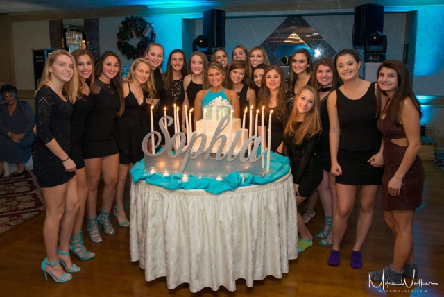 Group portrait at a sweet 16. Event photography by Mike Walker.