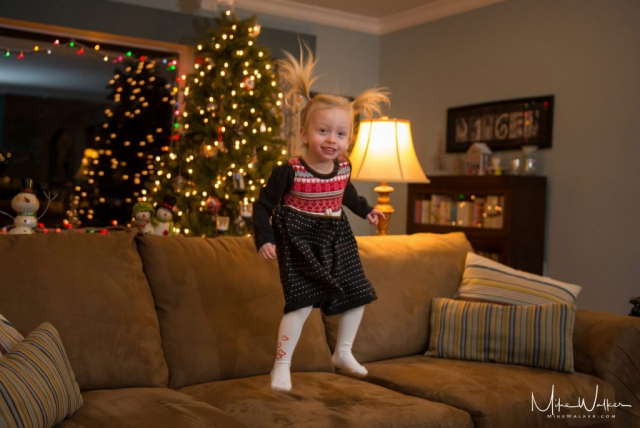 Young girl excited for the holidays. Family photography by Mike Walker.