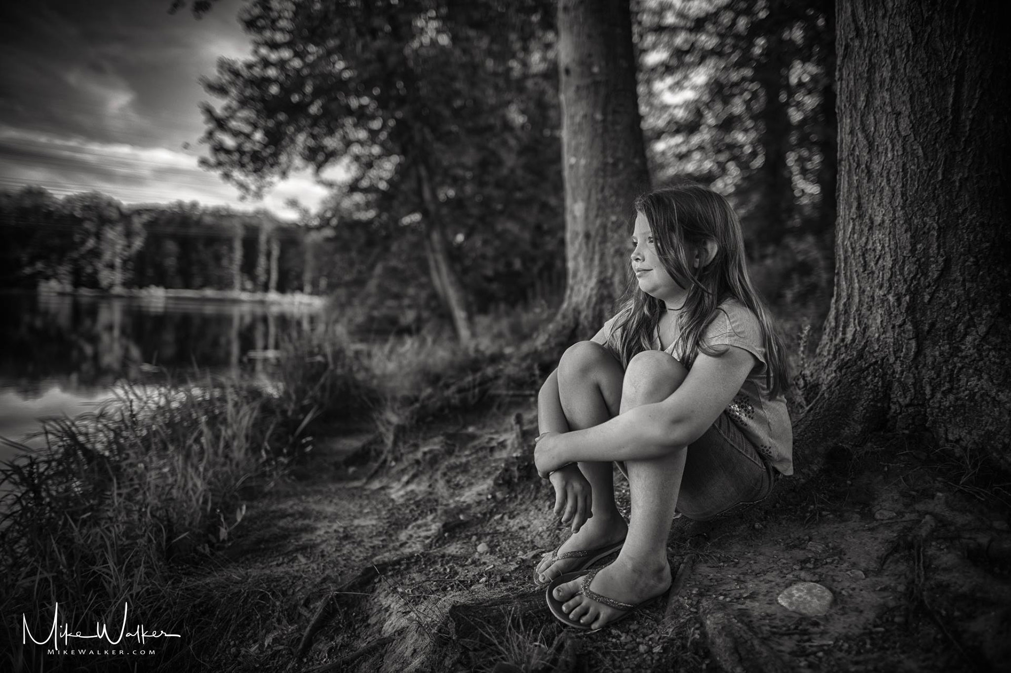 Amanda sitting by the pond. Family photography © Mike Walker.