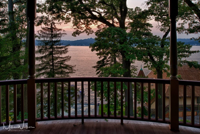 View of a lake from the porch of a home. Architectural photography by Mike Walker.