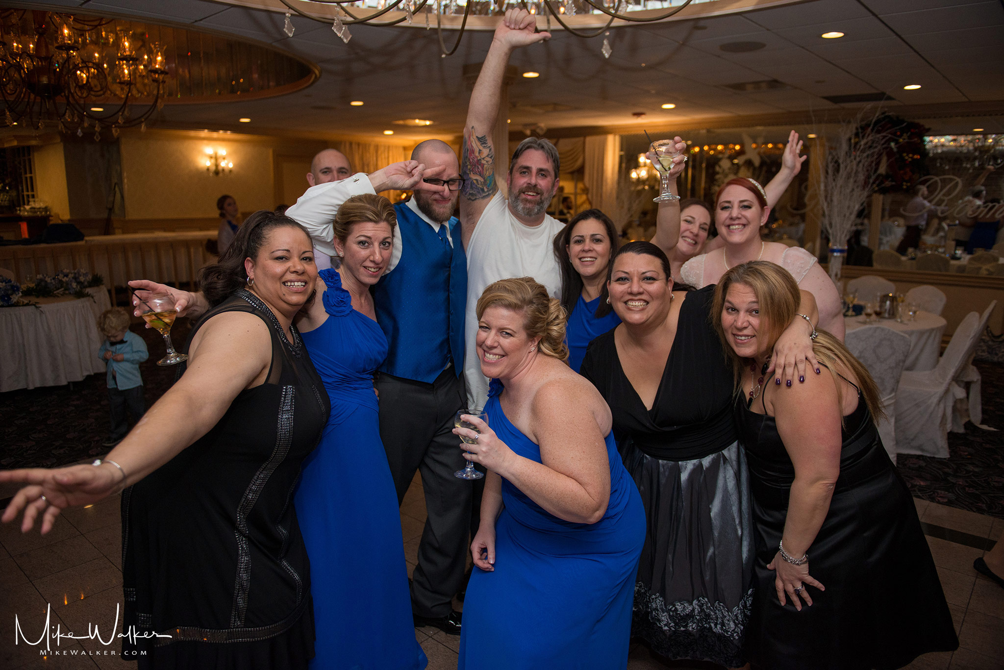 Wedding group partying on the dance floor. Wedding photography by Mike Walker.
