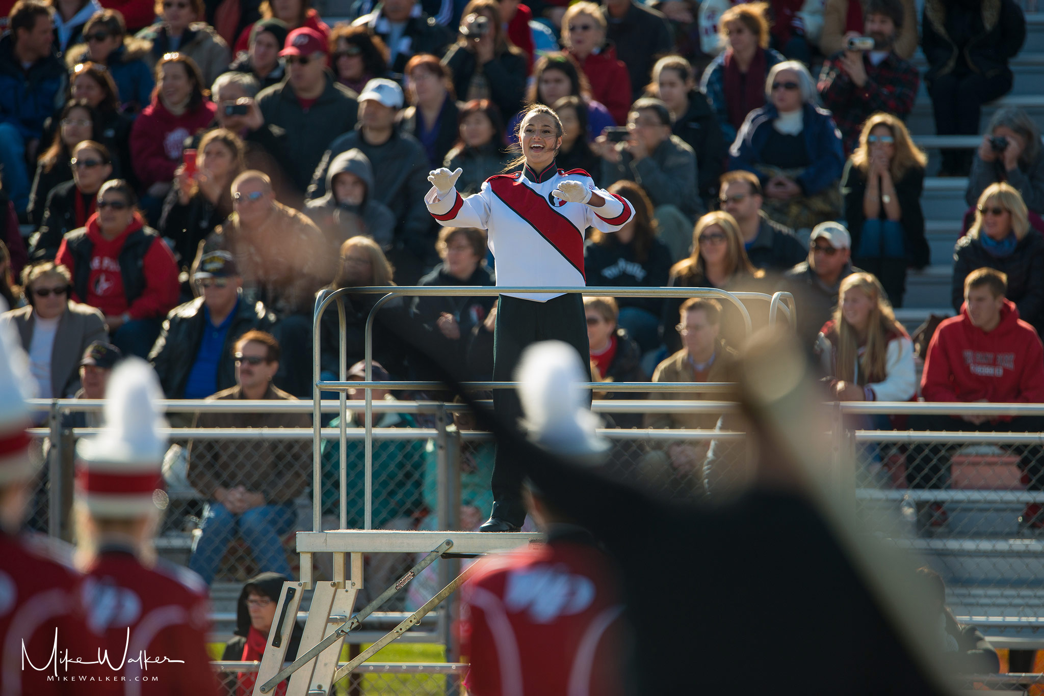Drum major conducting a marching band in NJ. Event photography by Mike Walker.