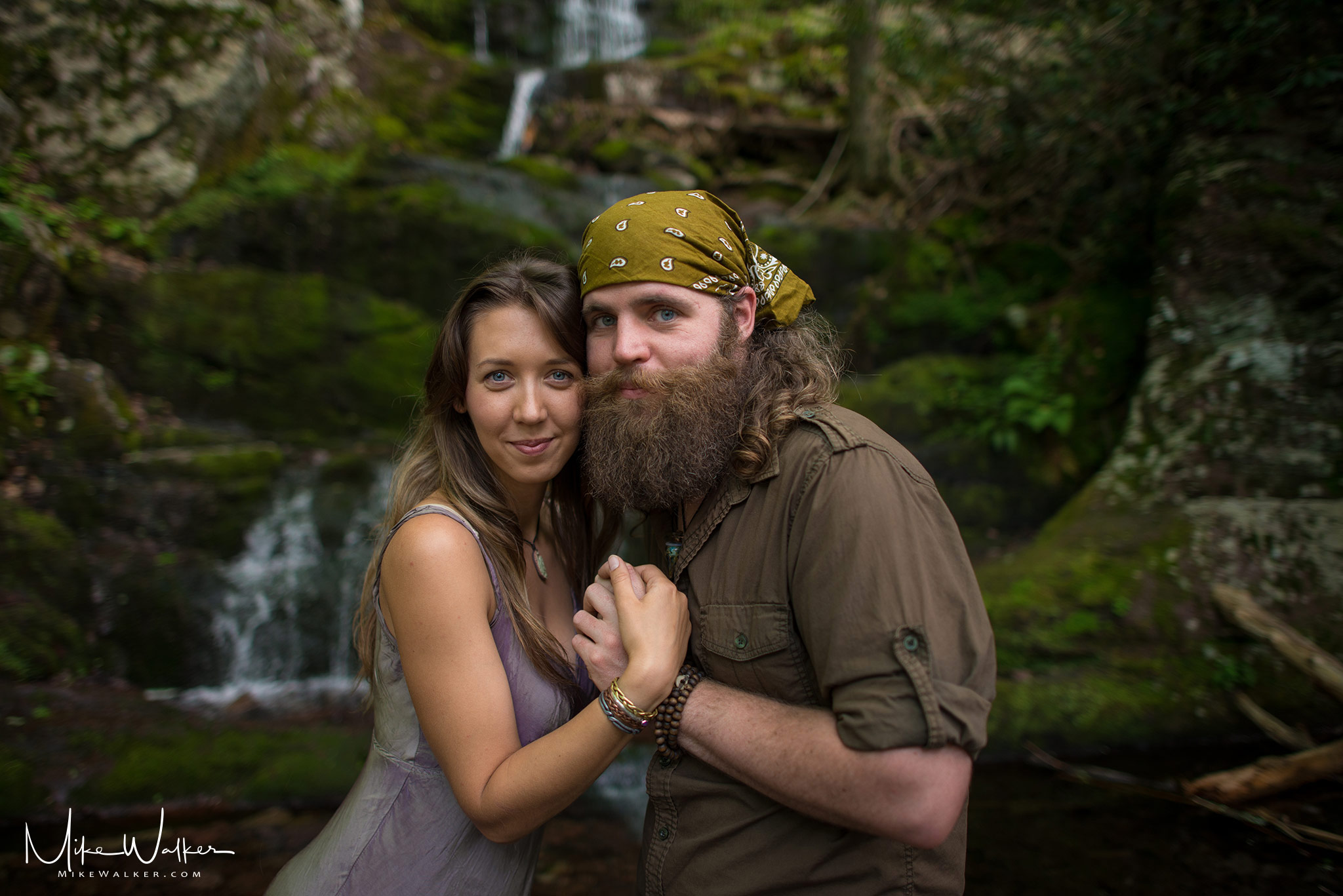 Couple in the woods for an engagement photo shoot by Mike Walker.
